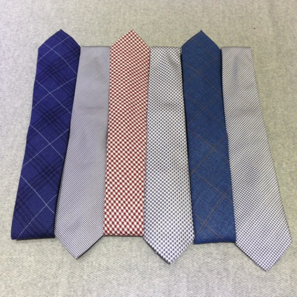 A selection of patterned ties, including 100% silk or Linen (50%), silk (35%) & cotton (15%)