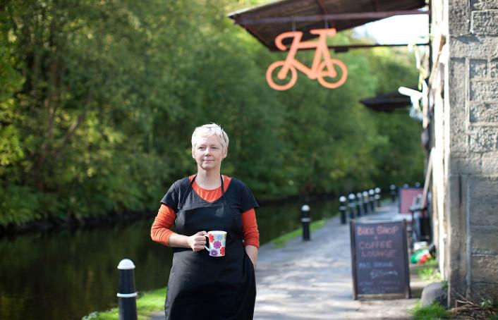 Bicycle Den owner enjoying a mug of coffee