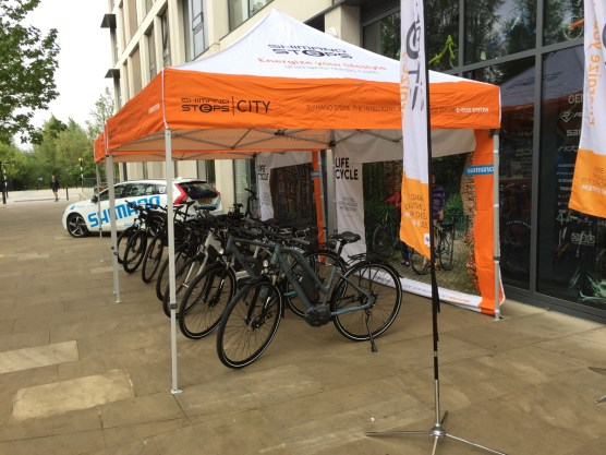 Shimano STEPS e-bikes lined up under Gazebo