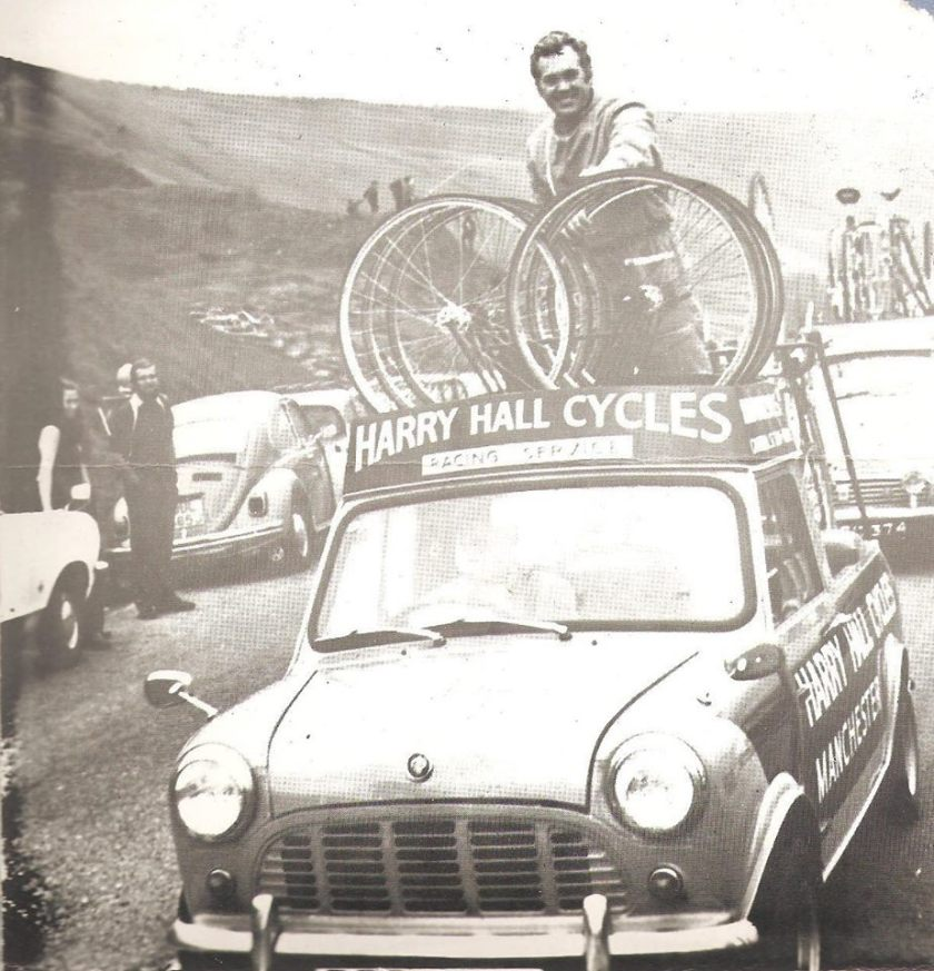 Vintage photo of Harry Hall from Harry Hall Cycles and his car