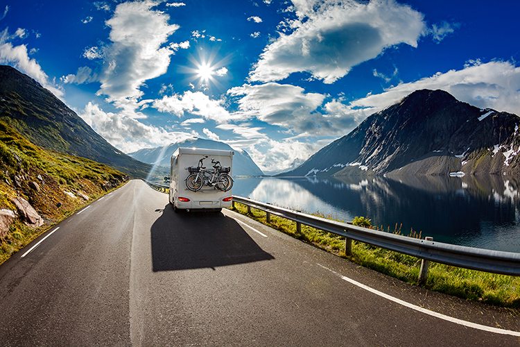 Motorhome carries electric bikes on the highway through the mountains