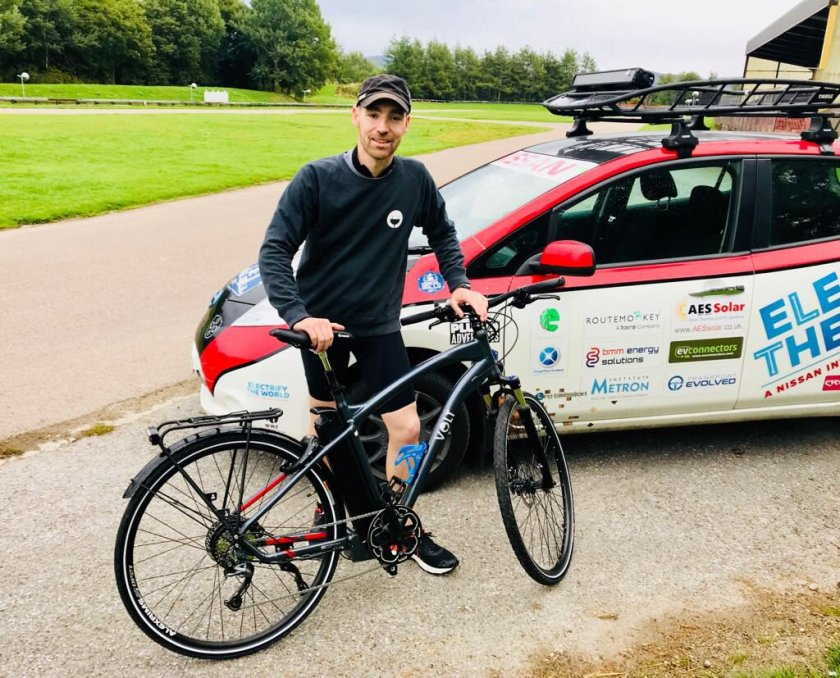 Chris Ramsey from Plug In Adventures poses next to the VOLT Pulse e-bike