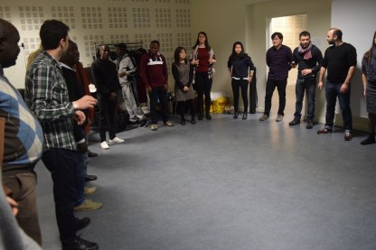 Big circle of 20+ participants and team members