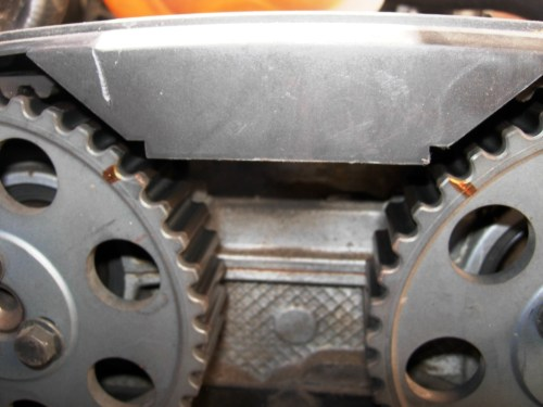 small resolution of highlighted camshaft sprocket timing marks so they are more easily seen to line up to reference notches in rear cover