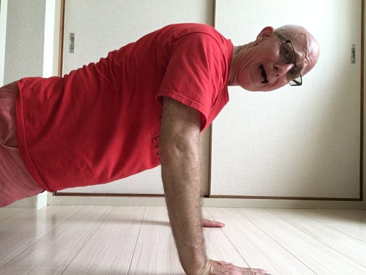 Von Baron does pushups for drummer fitness.
