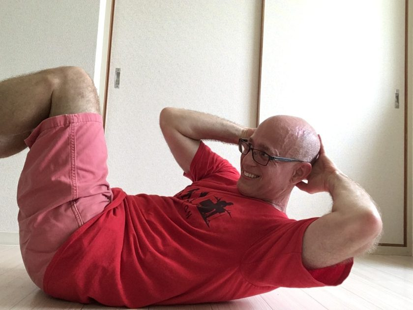 Von Baron does crunches for drummer fitness.