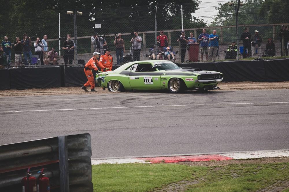 Marshals pushing Dodge Challenger TA back onto the track