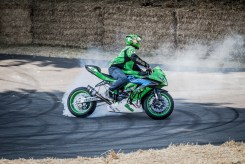 Stunt rider performing doughnuts for the crowd.