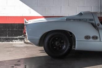 Porsche 910 parked quietly in the pit garage
