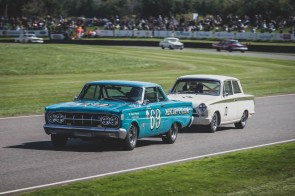 Roger Wills in the 64 Mercury Comet Cyclone leading Andrew Wolfe in the 65 MK1 Ford Lotus Cortina in the St Mary's Trophy part 1 @goodwoodrevival, Goodwood Revival.