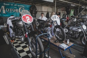 Motorbikes in the paddock garages at Goodwood