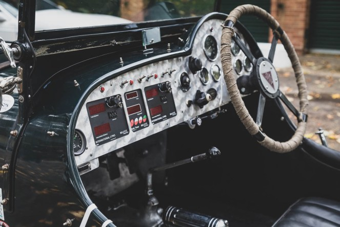 Modern additions to a vintage Alvis dashboard.