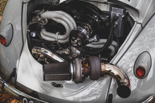 Large turbo hanging out the back of a VW Beetle