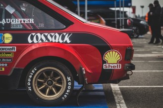 Red 1976 Ford Escort RS1800 with gold wheels
