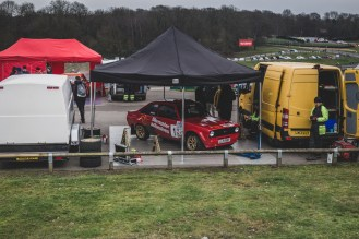 Red Ford Escort in the pits