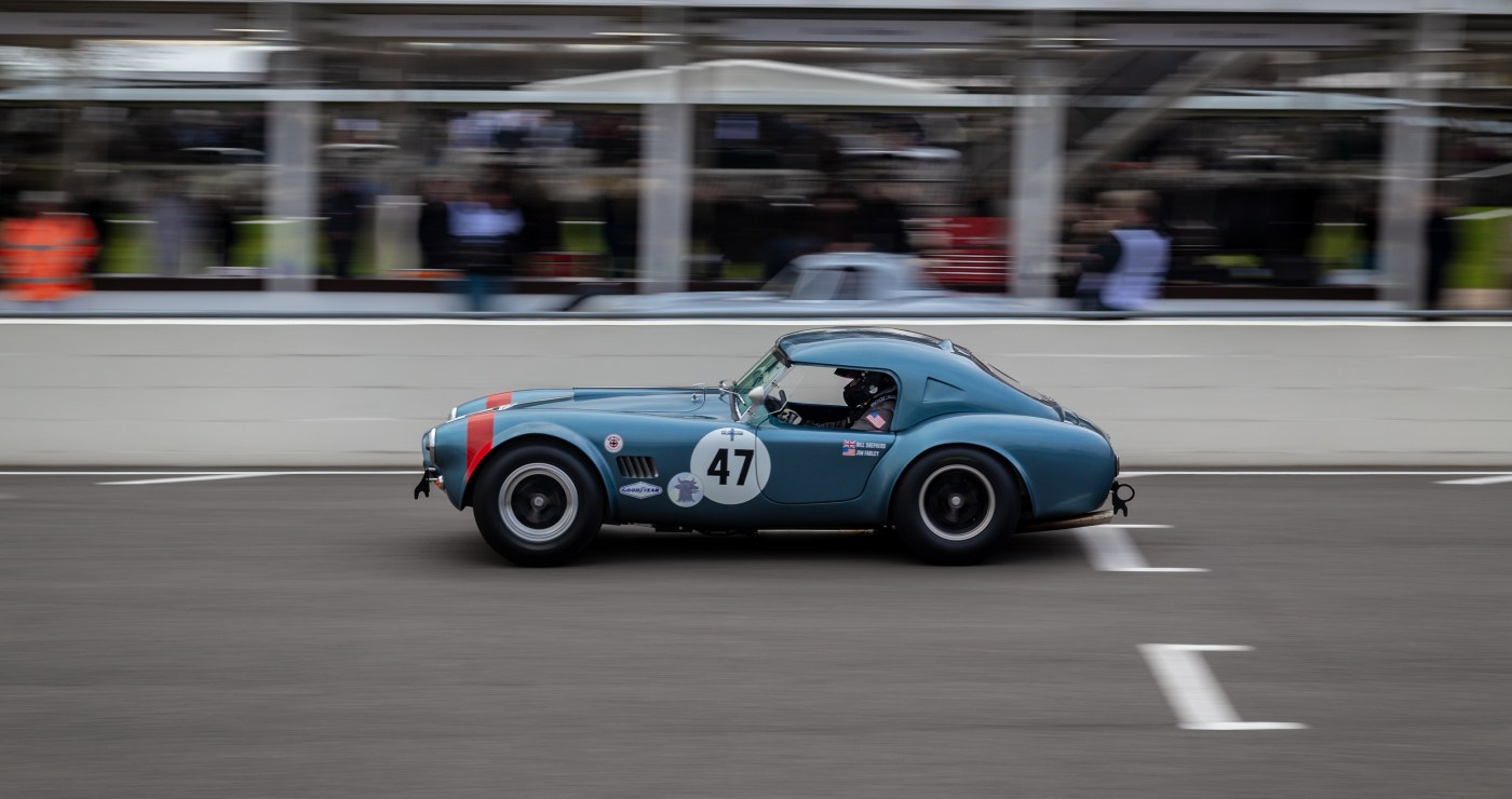 Blue AC Cobra race car at Goodwood 77 Members Meeting