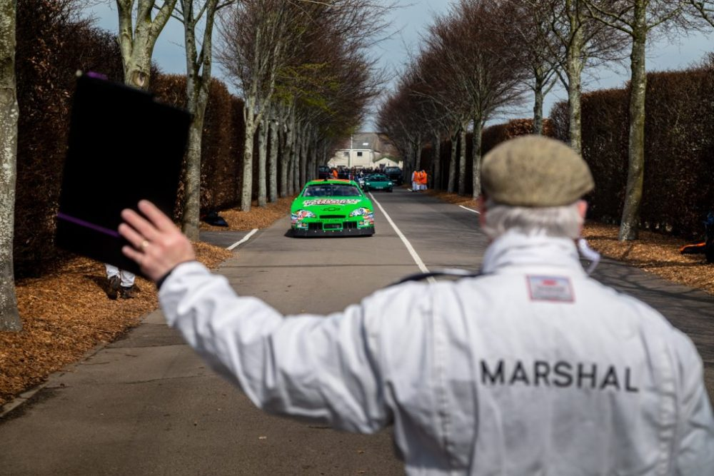 Race marshal signaling to nascar to stop