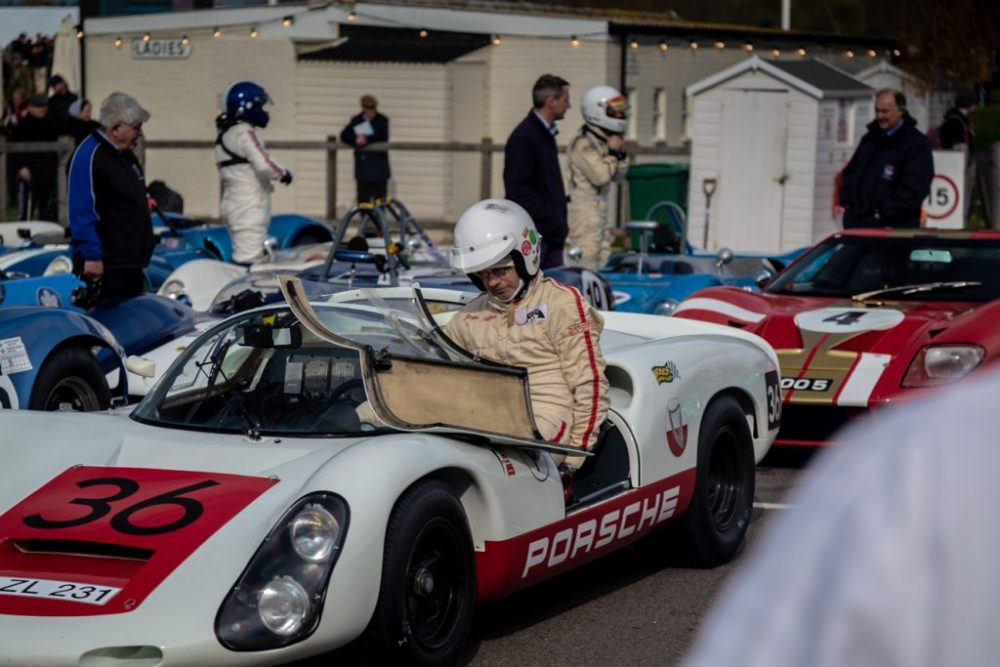 Driver climbing out of Porsche 910 race car