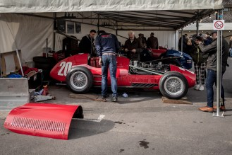Mechanics working on a Ferrari in the pits at Goodwood