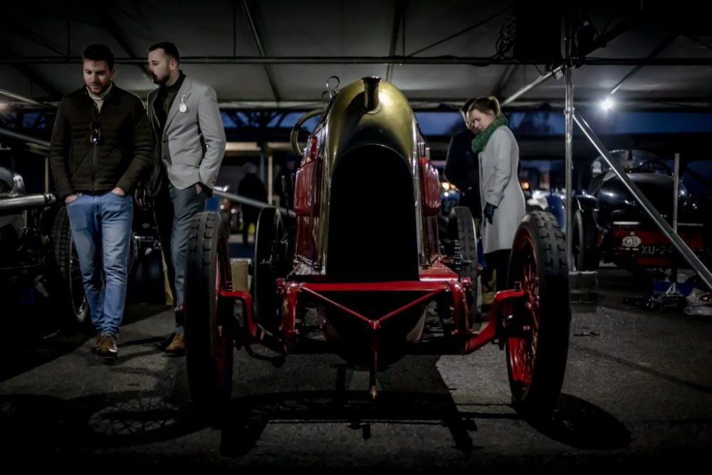 Vintage racing car in paddock at night