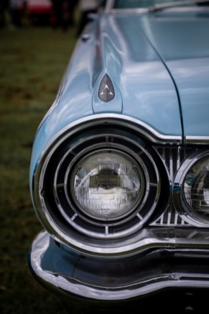 Front lights of light blue Dodge Polara Golden Anniversary