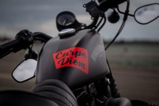 Black Harley Davidson Sportster with red Carpe Diem graphic