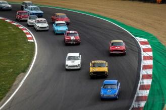 Classic cars racing round a corner
