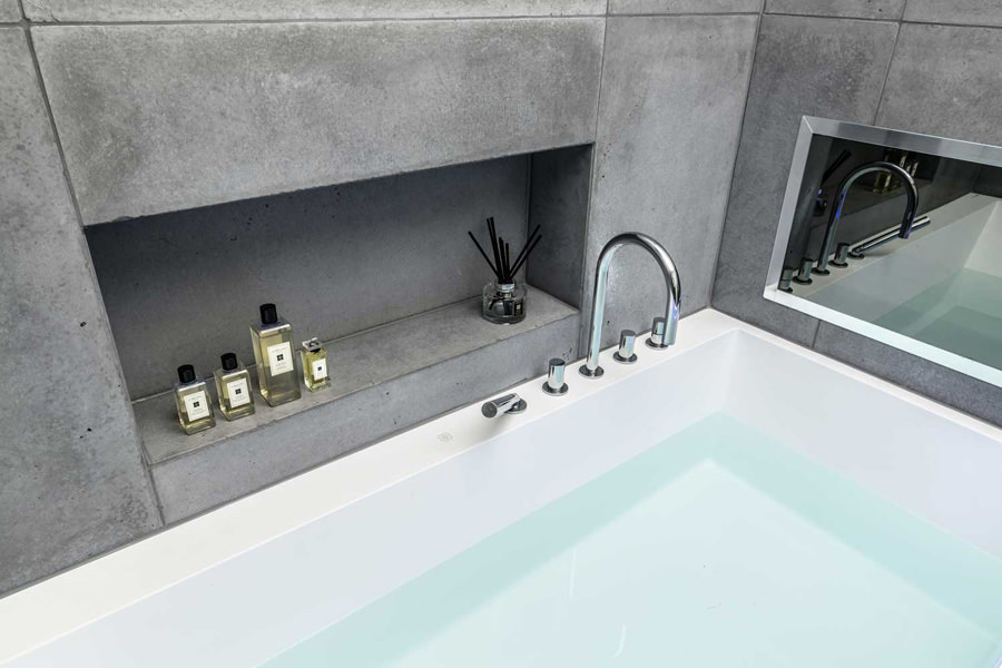 0244 bathroom with concrete tiles Aquavision TV and rectangular bath in St Johns Wood