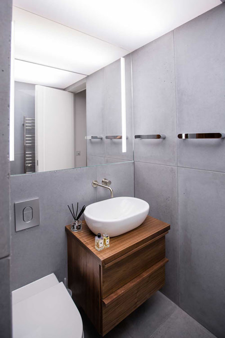 0244 concrete tiles bathroom and bowl basin with wooden vanity unit in north west london