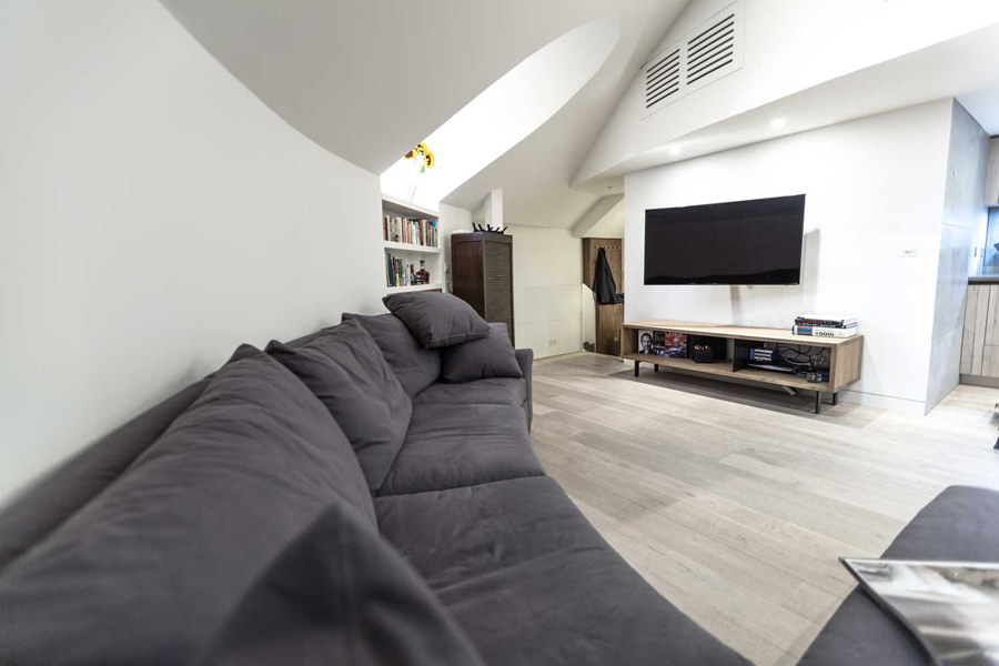 0244 living room with curved L shape grey sofa and wall hung TV with contemporary interiors