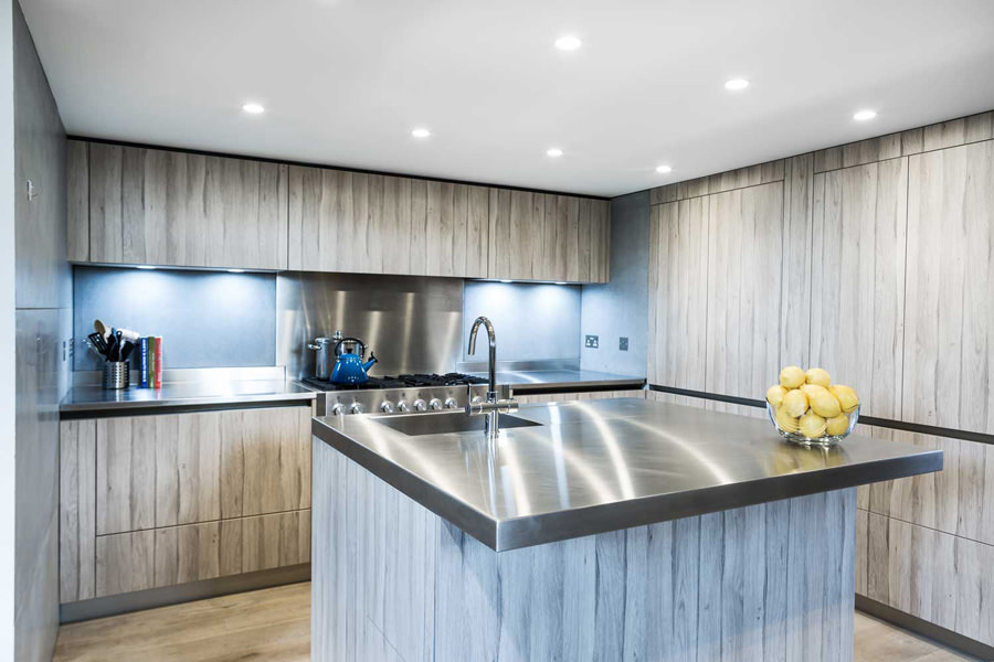 0244 modern kitchen with concrete tiles steel worktops and grey wood cabinets in penthouse apartment