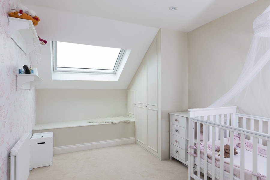 0631 children bedroom in loft with built in storage wardrobe and roof light