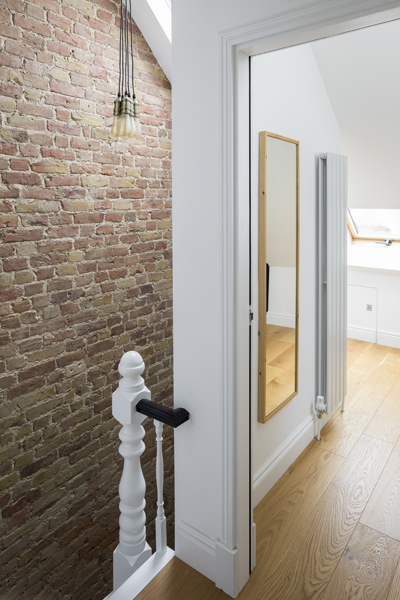 0557 exposed brick wall in staircase in traditional terraced house in wimbledon