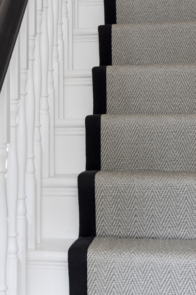 0557 grey pattern pattern carpet runner and white wooden steps in terraced house london
