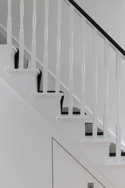 0557 white wooden staircase with black balustrade in traditional london house