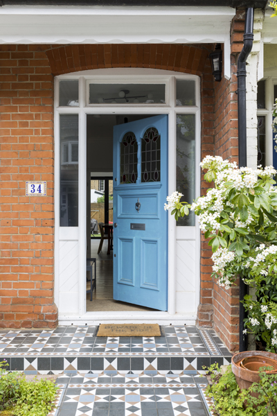 0557 blue entrance door and pattern external tiles to a house in South West London