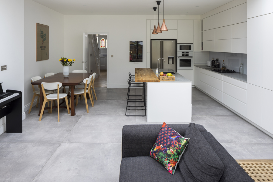 0557 rear extension with kitchen diner and white cabinets and grey floor