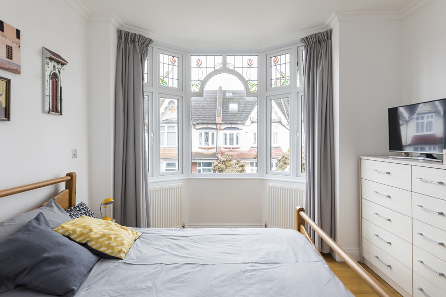 0557 guest bedroom with bay window and white walls in wimbledon