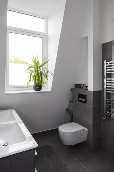 0557 loft bathroom with dark grey tiles and white walls in south west london
