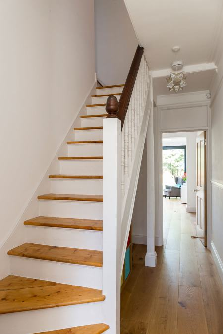 0558 terraced house staircase with wooden steps and white balustrade in London