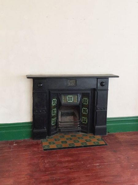 0736 traditional iron cast and green tiles fireplace