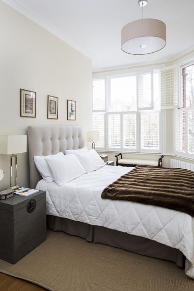 0736 beige master bedroom with bay window and shutters