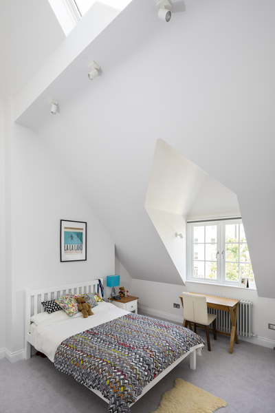 0776 childrens bedroom in loft with sloped ceiling in London NW6