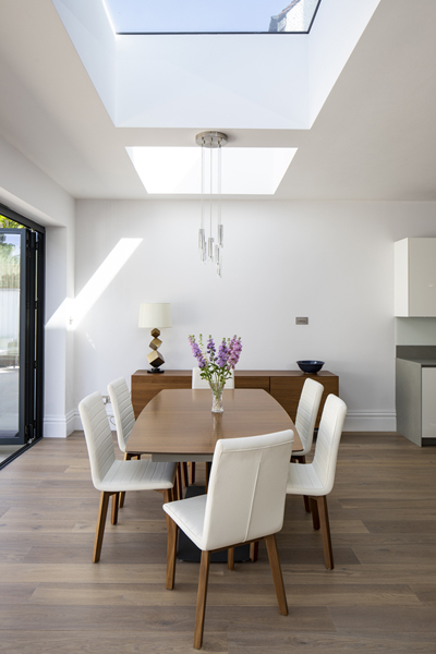 0776 dining area in a rear extension with mid century dining table and white leather chairs