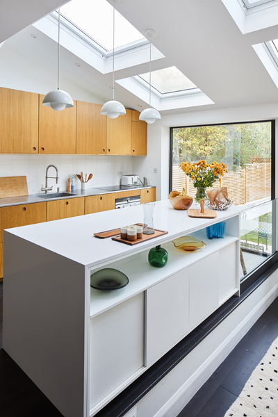 0848 sloped kitchen extension roof with roof lights white island and veneer cabinets earsfield