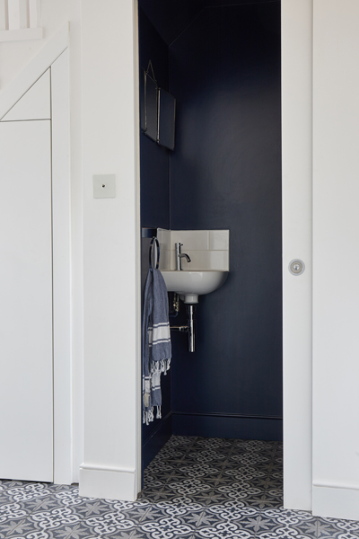 0848 under stairs cloak room with blue walls and storage in SW18