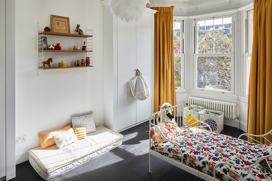 0848 children bedroom with yellow curtains and white metal frame bed in south west london