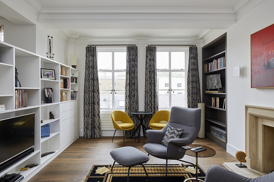 reading room mid century style London yellow chairs grey arm chair