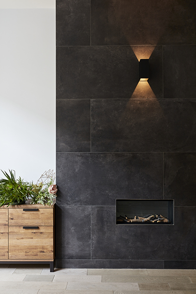 black stone clad fire place industrial design