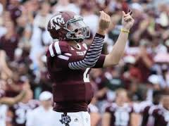 Jonny Manziel throws up his signurature 'Money' pose.